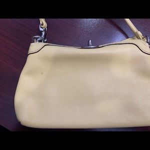 Coach Yellow Leather Turnlock Wristlet